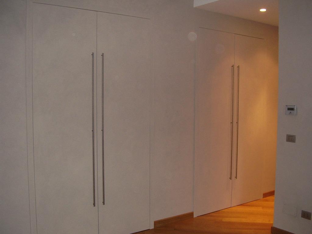 Porte cabina armadio artigianlegno - Porte scorrevoli per cabina armadio ...